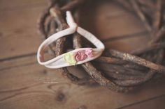 A peachy headband with a yellow silk chiffon petal, a pink chiffon nest and some pink berriesnewborn size