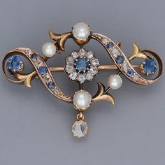 Sapphire, diamond, pearl and gold brooch.