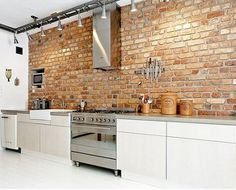 brick backsplash+stainless steel appliances w/ white cabinets= industrial feel