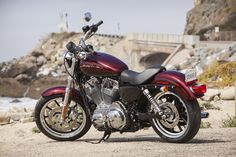 Challenge traditions with this thoroughly modern scarlet lady. | Harley-Davidson Iron 883 XL Superlow