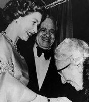 "Agatha Christie meets HM Queen Elizabeth II during the royal premiere of the movie ""Murder On The Orient Express,"" adapted from her book, at the ABC cinema in London. In the center of the photograph is the EMI president, Nat Cohen."