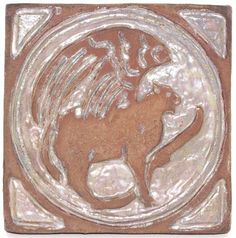 "168.	Rare Pewabic tile, carved winged creature in brown clay with iridescent glaze highlights, unmarked, 7.5""sq., mint 700-900"