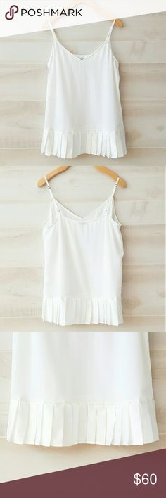 Equipment Layla Silk Pleated Hem Tank This beautiful silk tank features adjustable spaghetti straps, v-neck and pleated satin hem. Color name Bright White. Size small. Nwot. Listed on Posh only. 🚫 NO TRADE OR HOLD 🚫 Equipment Tops Tank Tops