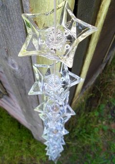 Dollar store glass candle holders are drilled and joined together with fine linked chains to make a rain chain