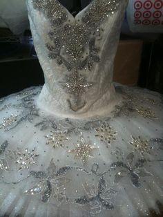 Silver embellishments.Tutu.com