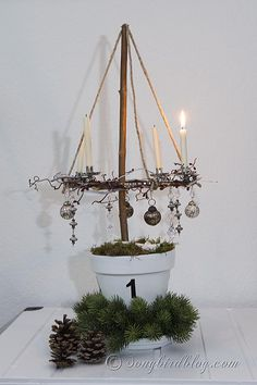 Start your Christmas decorations and make this four candle Advent wreath that floats in the air. Instructions at : http://www.songbirdblog.c...