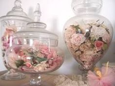 dried roses in apothecary jars