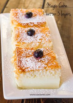 Magic Cake - Use Gluten Free Flour 4 eggs at room temperature 150 g sugar (3/4 cup) 125 g butter unsalted and melted (1 stick or 1/2 cup) 1 tsp vanilla extract 115 g all-purpose flour (4 oz or 3/4 cup) 500 ml milk lukewarm (2 cups) * powdered sugar for dusting cake