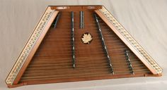 2008 - #1439 - A James Jones 4/19/21/9 Custom Hammered Dulcimer with a Birdseye Maple frame and pin panels, Stained Redwood SB, with Ebony bridges and Cocobolo  trim. Mahogany dampers.
