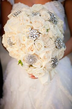 white rose bridal bouquet with rhinestone brooches. Except I would go for slightly smaller rhinestones