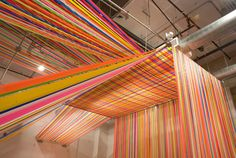 Megan Geckler is a Los Angeles-based installation artist who creates site-specific one-of-a-kind installations using flagging tape. Flagging tape, which Megan discovered in graduate school, is a plastic ribbon typically used by construction workers on sites to mark space.