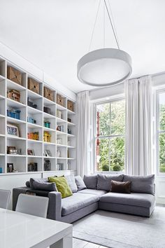 Daniele's solution for storage in the sitting room was 3.8-metre high, floor-to-ceiling bookshelves.