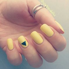 Triangle accent on yellow nails