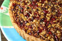 Just out of the oven: Three-Nut Pie with Cranberries--smells heavenly!  I used pistachios, almonds, and walnuts. Here is the link to the recipe:  http://www.epicurious.com/recipes/food/views/THREE-NUT-PIE-WITH-CRANBERRIES-2692