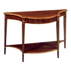 Style #FOC-2-Console table with shaped top and bottom shelf. Shown in mahogany and mahogany veneers with satinwood banding, floral inlays and stringing.