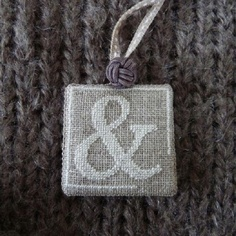 Cross stitch and an ampersand ... Absolutely.