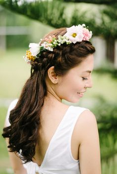 Braided hairstyle with crown flowers are the best ideas for garden wedding party | Rustic Bohemian Wedding At Casa San Pablo, Philippines | http://www.bridestory.com/blog/rustic-bohemian-wedding-at-casa-san-pablo-philippines