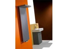 Zana-Libra is a bathroom radiator that has a rigid rectangular tube configuration and L-shaped tubes. The vertical version offers the possibility of drying or stacking towels, whereas the horizontal version is designed primarily as a corner-piece above the bath or in another room.