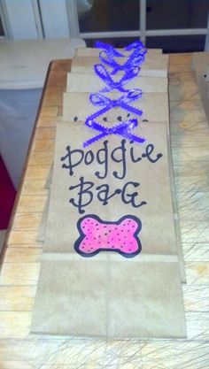 Littlest pet shop party favor bags <3.                            What a great idea!   So adorable.