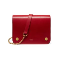 Shop the Clifton in Scarlet Crossboarded Calf at Mulberry.com, a new compact, cross body style that cleverly camouflages an organiser's paradise underneath its neat exterior. Three zipped internal pockets provide ample room for essentials, and the chain strap can be adjusted from cross body to shoulder for additional versatility. The Clifton features Creative Director Johnny Coca's signature detailing: modern flat press studs for a contemporary touch.