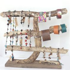 No need to buy an expensive jewelry box...check out this driftwood display.  Besides a few nails and some elbow grease, its free!