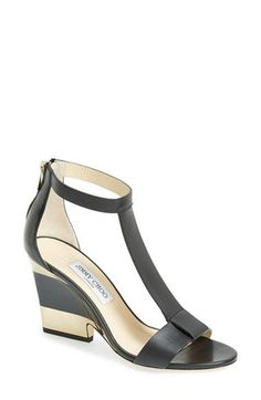 Jimmy Choo T-Strap Wedge Sandal (Women) at Nordstrom.com. Mirror-bright goldtone trim wraps the sculpted heel of a graceful T-strap sandal in smooth, lightly glazed Italian leather.