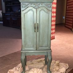 "My first chalk paint project! One coat of Annie Sloan Duck Egg Blue, one coat clear wax, one coat of clear and dark wax mixed. This was an ugly, old ""oak"" laminate jewelry armoire."