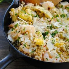 Lemon and Artichoke Couscous with Shrimp Recipe Main Dishes with less sodium chicken broth, pearl couscous, olive oil, garlic cloves, shallots, artichokes, deveined shrimp, ground black pepper, red pepper flakes, lemon, lemon, fresh dill, fresh parsley, parmesan cheese