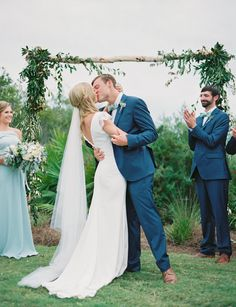 Birch wood arch with soft greenery make a perfect back drop for the ceremony.  Created by Bella Flora 30a on the Inn Green at Watercolor.