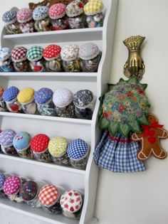 Creating attractive storage for haberdashery using Ikea storage jars covered with vintage fabric.