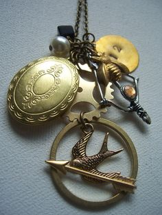 Mockingjay, Peeta's locket, Bow & arrow charms. #HungerGames  I want this so badly!!