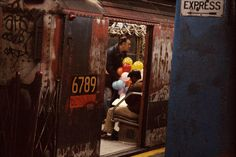 1984, New York, balloons in the subway by Frank Horvat