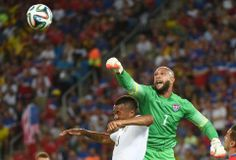 US goalkeeper Tim Howard (R) vies with Ghana's forward Jordan Ayew (L) during a Group G football match between Ghana and US at the Dunas Arena in Natal during the 2014 FIFA World Cup on June 16, 2014. AFP PHOTO / EMMANUEL DUNANDEMMANUEL DUNAND/AFP/Getty Images