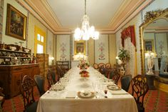 Hospitality gleams in Belmont Mansion's formal dining room, with eighteen settings for guests (Nashville, Tennessee)