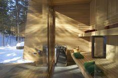 forest-getaway-cabin-dominated-by-warm-wood-boards-12-sauna.jpg