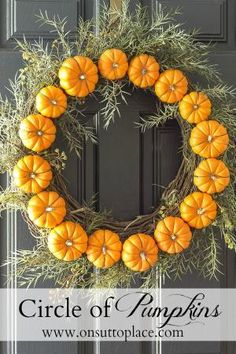 Make this Circle Pumpkin Wreath in less than 30 minutes. All you need is wire, pumpkins and (of course) a wreath! by carlene