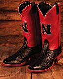 Officially licensed Husker Cowboy Boots by Nocona®. London calf upper, full quill ostrich foot, narrow square toe, underslung walking heel, single stitched welt, leather sole, pull tabs, embroidered logo and brass peg.  Made in USA.