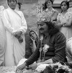 Meher Baba at Tomb.  1938.  Kitty in background.