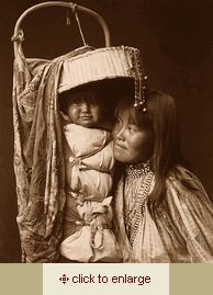 Edward Curtis photograph. 1903. Apache woman and child in papoose.