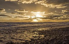 Sunset at a rocky beach - null