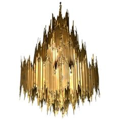 Massive Tom Greene Torch Cut Brutalist Chandelier | From a unique collection of antique and modern chandeliers and pendants at https://www.1stdibs.com/furniture/lighting/chandeliers-pendant-lights/