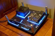 """This nicely put togetherwall-mounted PC is ultimately the goal of many custom computer builders. Recoil P -owner of this system- calls it """"The RecoilMachine"""", which took him over 2 months to order and assemble the rig. Also according to Recoil P, he uses Plexiglass as the backplate for each component before having them planted firmly on a large vinyl-clad hardboard. RecoilMachine has single loop water-cooling setup, Gigabyte EX58-UDP5, Intel Core i7 920 Socket-1366, Asus GTX 590, Samsung…"""