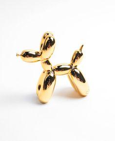 Sculpture de chien en résine métallisée or