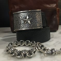 Hammered Sterling Silver Trophy Buckle with 5 point star, from master silversmith Clint Orms, on a black ringtail lizard belt.  Shown with hand cast sterling silver link bracelet from Jeff Deegan.
