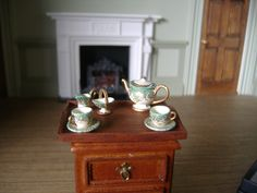 Victoria Fasken - hand painted pewter tea set, Teapot, milk jug, sugar bowl and 2 x cups & saucers,  with mahogany tray by McQueenie; sold on ebay for £26.89 (approx $42)