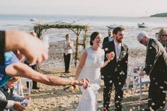 Waterfront Cape Cod Wedding   Photo by Henry + Mac