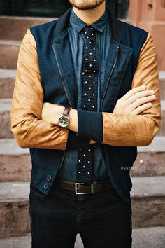 Shop this look on Lookastic:  http://lookastic.com/men/looks/dress-shirt-tie-bomber-jacket-watch-belt-jeans/9603  — Navy Chambray Dress Shirt  — Black and White Polka Dot Tie  — Navy Bomber Jacket  — Dark Brown Leather Watch  — Dark Brown Leather Belt  — Black Jeans