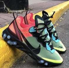 """The Nike React Element are back in 2019 and releasing the striking Nike React Element 87 Volt Racer Pink. This React 87 is sporting a green upper with red and blue accents, black Nike """"Swoosh"""", black midsole, and blue sole. Kicks Shoes, New Shoes, Men's Shoes, Shoe Boots, Shoes Sneakers, Green Sneakers, Girls Sneakers, Basket Originale, Zapatillas Nike Jordan"""