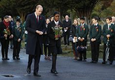 The royal walks with Michaela McKay, 14, from St Michael's Youth Project, to lay a floral tribute at Willesden New Cemetery