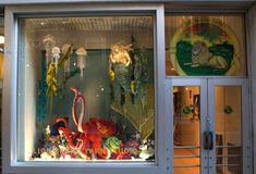 This is the seasonal display window for Lion Brand's brick and mortar yarn shop. Not all of the patterns are available from Lion Brand, but there are some, and there are similar patterns you can easily find on Ravelry. Isn't it gorgeous?